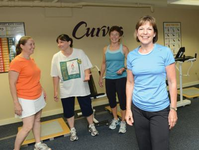 Sue Graham, far right, bought the Curves in Waterbury shortly after Tropical Storm Irene nearly forced its closure.