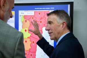 Gov. Phil Scott looks at a live map of power outages