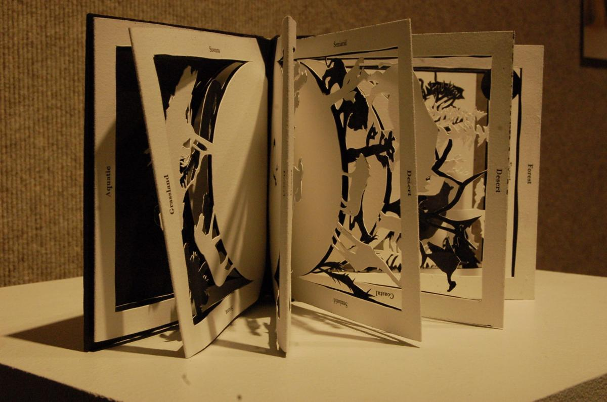 Die-cut art as book pages
