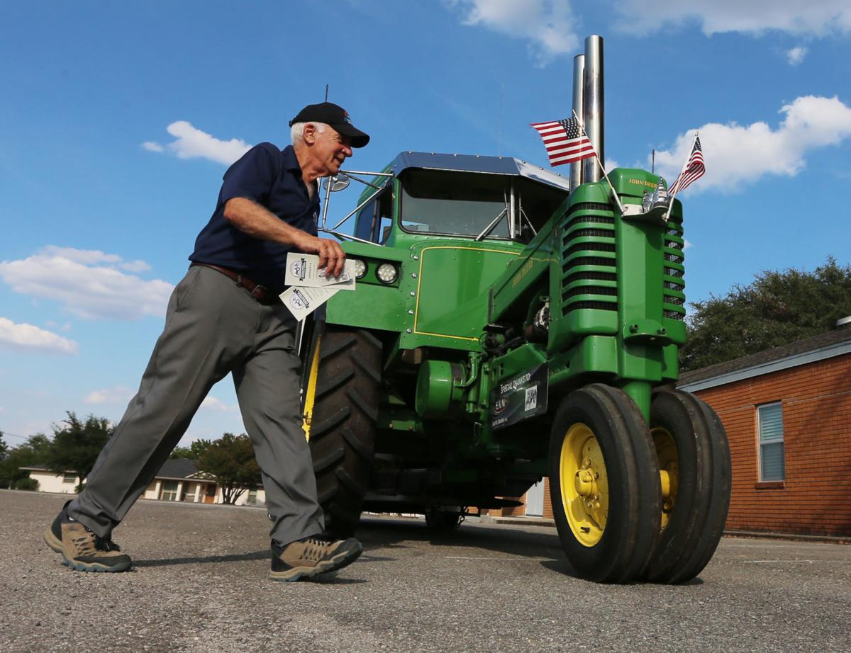 Pennsylvania man motors through town on 1948 tractor