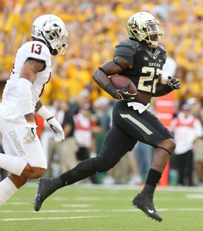 354c4a35731 bu football. Baylor running back Terence Williams (right) scores ...