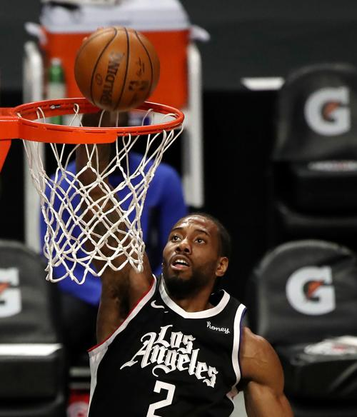 Kawhi Leonard of the Los Angeles Clippers dunks against the Houston Rockets during the second quarter at Staples Center on Friday, April 9, 2021, in Los Angeles.