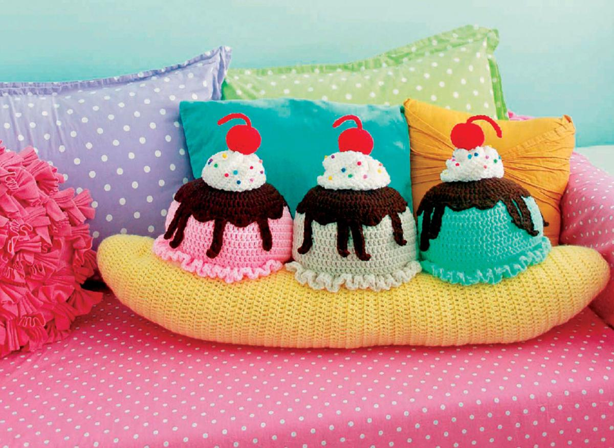 """A banana split throw pillow is featured in the book """"Crocheted Abode a La  Mode: 20 Yummy Crochet Projects for Your Home,"""" by Twinkie Chan."""
