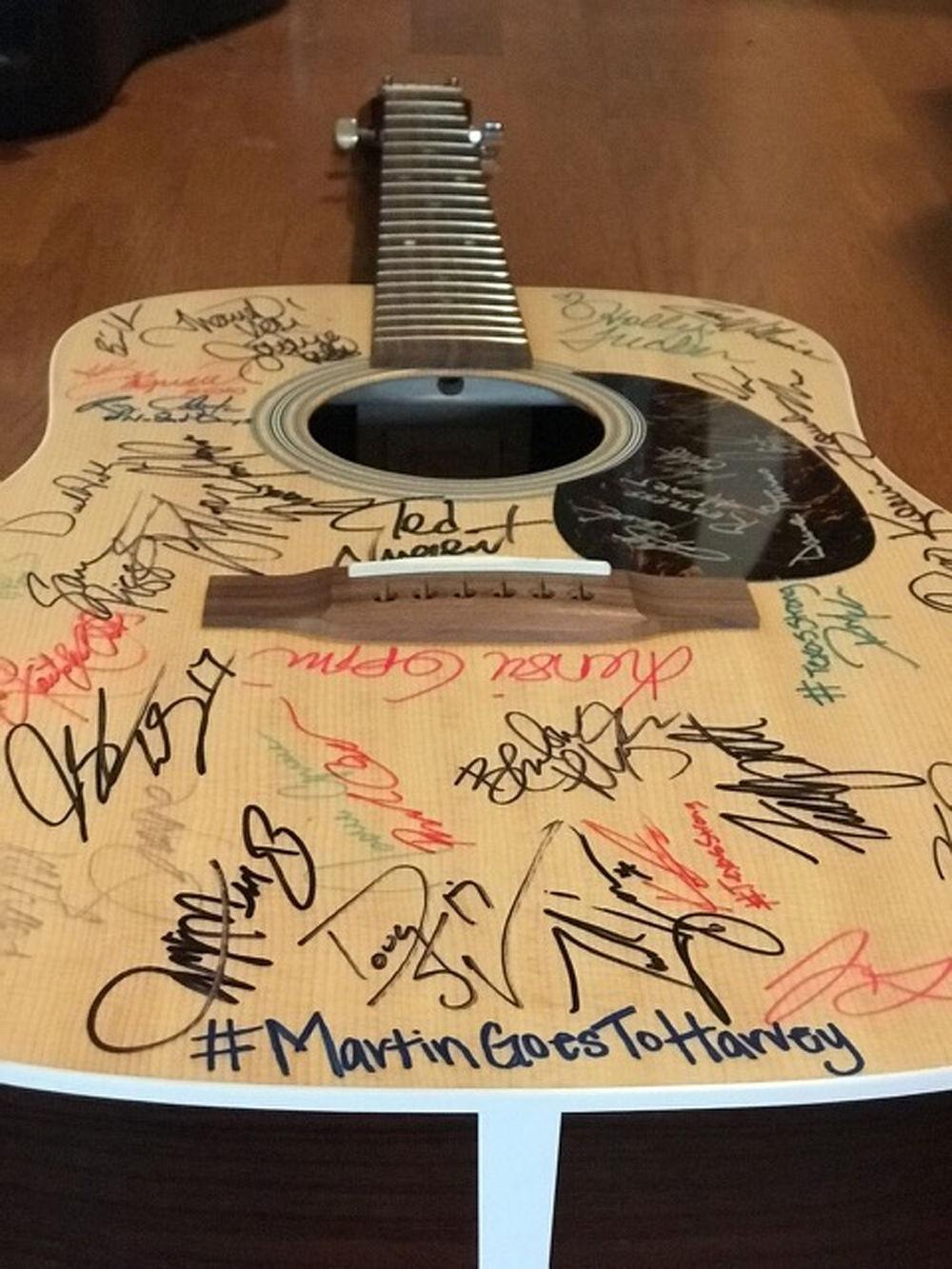 Holly Tucker signed guitar