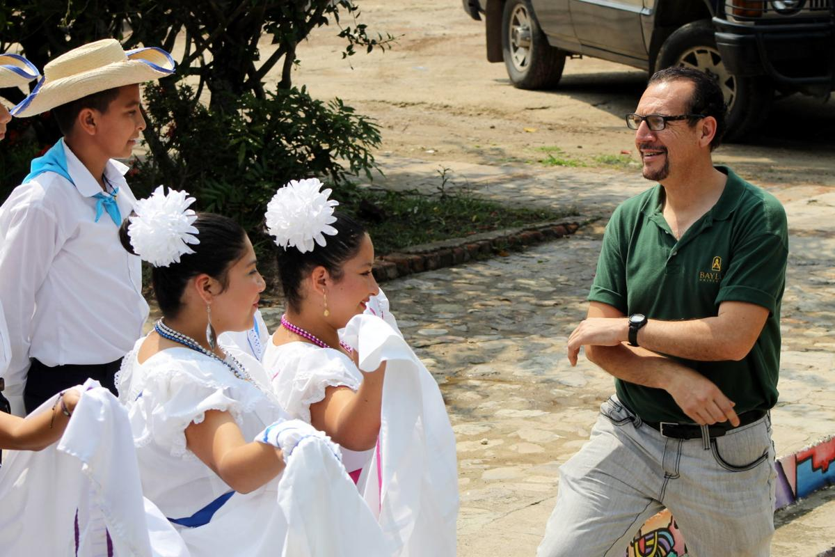 Carlos Colon with dancers