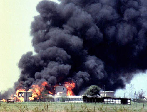The Branch Davidian compound engulfed in flames on April 19, 1993.