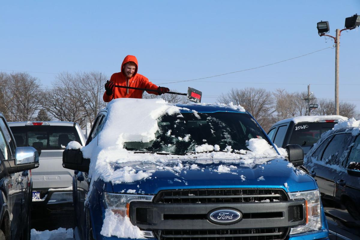 Outside Work Sid Dillon Ford Employee Zac Lamprecht Pushes Snow Off One Of The Vehicles In Lot Wahoo Last Wednesday Afternoon