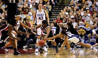 Jade Perry #55, center, and Crystal Langhorne #1, far left, of the Maryland Terrapins fight for a loose ball with Monique Currie #25, right, Mistie Williams#, and Alison Bales #43, all of the Duke Blue Devils, during the 2006 NCAA Women's Basketball Championship Game on April 4, 2006 at the TD Banknorth Garden in Boston, Massachusetts.