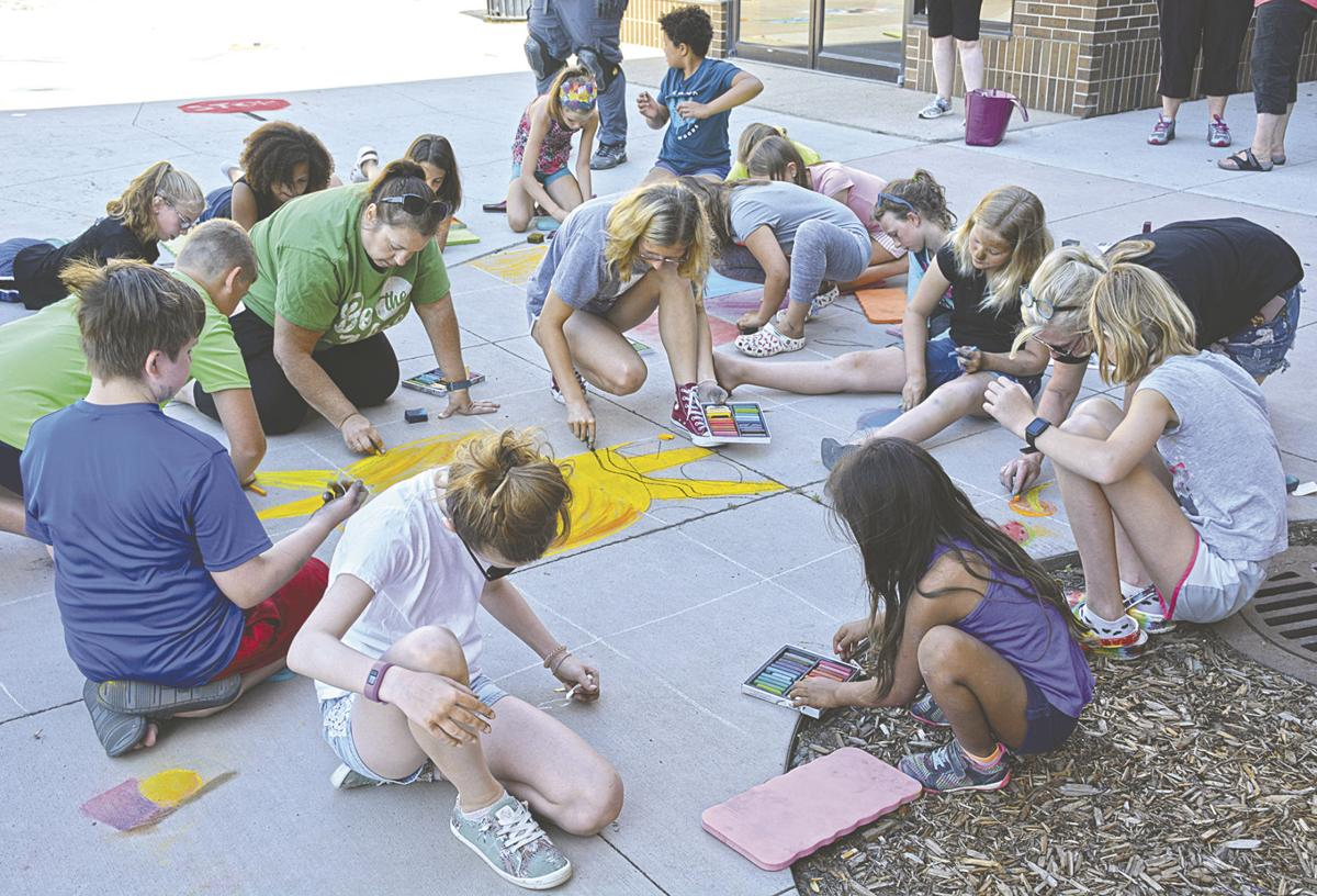 Chalk art quilt created in Heritage Square