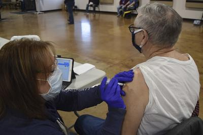 County holds first public COVID-19 vaccination