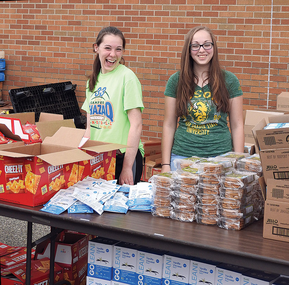 Community benefits from free surplus food drop | Local News Stories ...