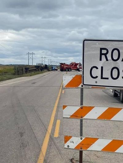 Semi hits 'Road Closed' sign, crashes into ditch