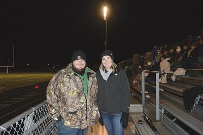 Small communities love their high school football teams. Fans like Jenn Tolbert and Gary Phillips are even willing to travel to away games — just so they can see well-played football.