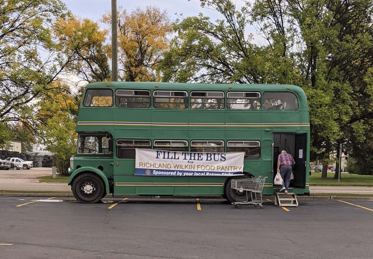 'Fill the Bus' collects 8,249 pounds of food, raises $1,232