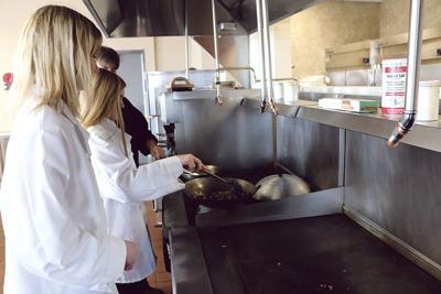 Culinary arts students learn kitchen basics