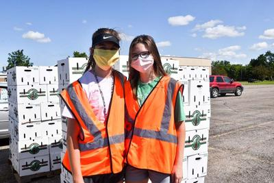 Food bank distributes 700 produce boxes to Twin Towns