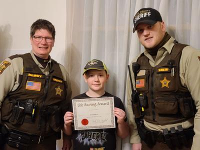 Wolverton boy alerts neighbors of fire, saves their dog