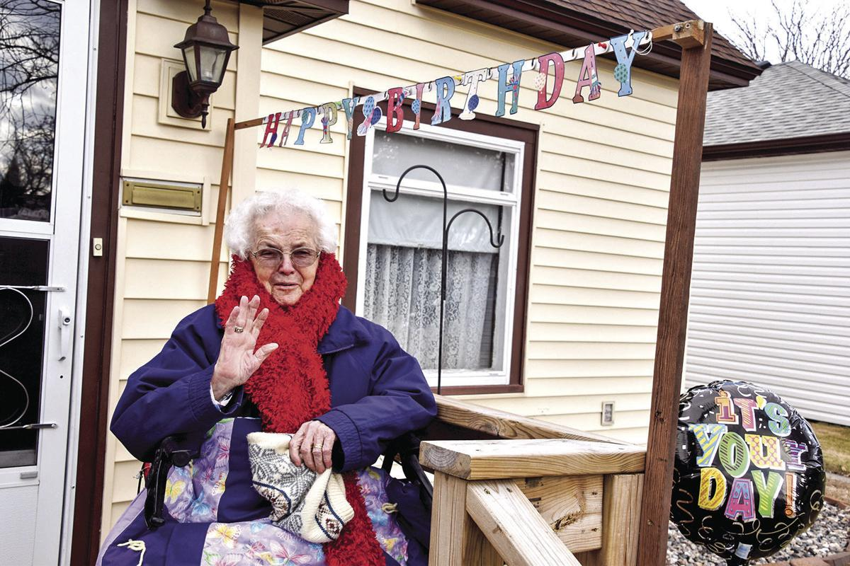 Family, friends hold birthday parade for 100-year-old