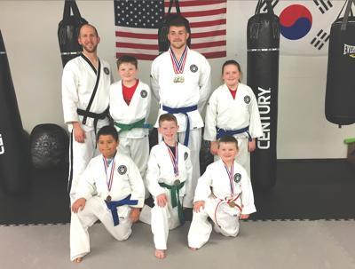 Local martial arts students bring home medals
