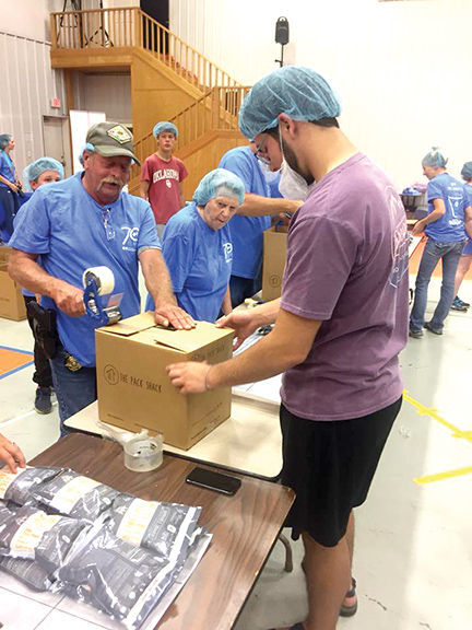City of Waldron gathered together to pack 30,000 meals for Scott County