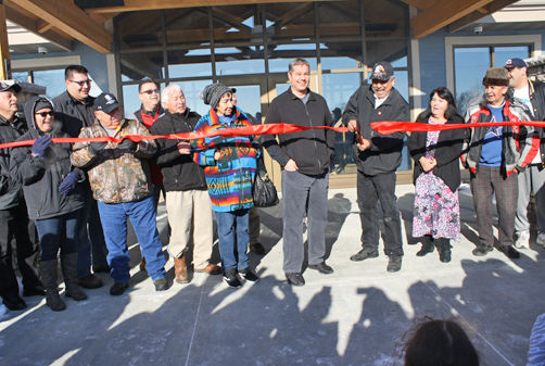 Members of the Leech Lake Tribal Council and others were on hand for the Feb. 10 ribbon-cutting ceremony to open the new Onigum Community Center.