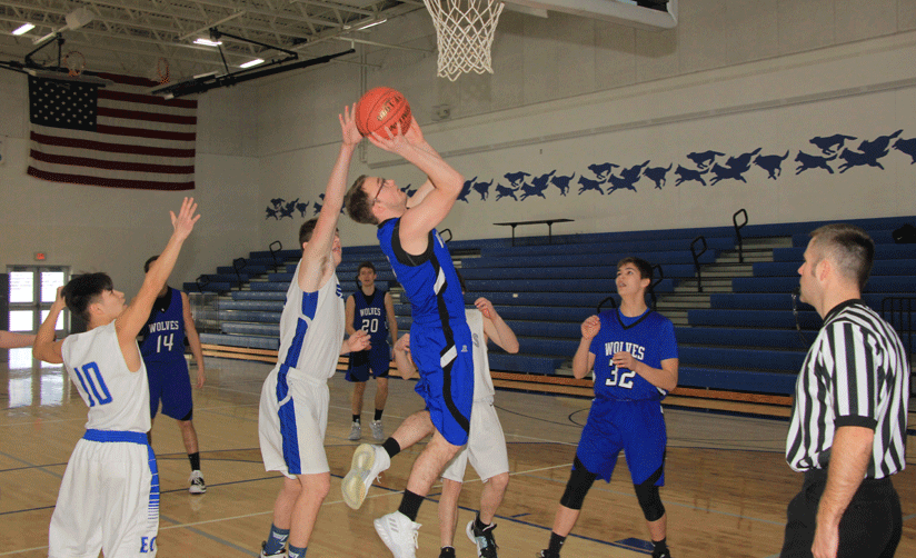 Brad Stenger scores two of his eight points in the Wolves' win over East Central.