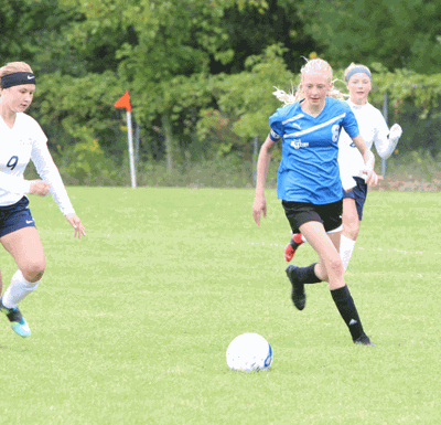 Erika Rand brings the ball up the field during the Wolves' 6-0 home loss to Crookston.