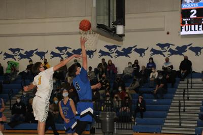 Kenseth Taylor scores two of his team-high 16 points in a home loss to Nevis.