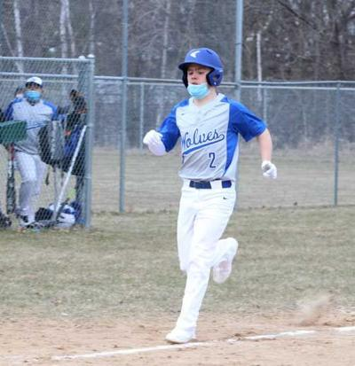 Caden Opheim heads for home in WHA's 26-8 win at Laporte. WHA trailed 6-3, but scored five runs in the fourth and nine in each of the next two innings.