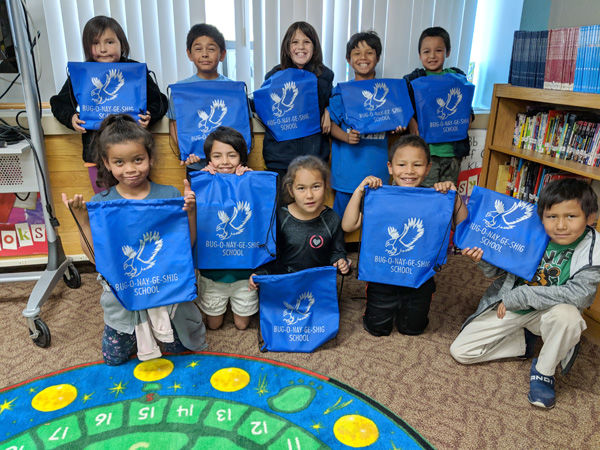 First grade receives backpacks