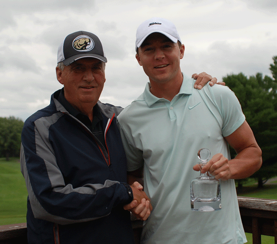 Tianna Shortstop Tournament Director Ray Sauer (left) hands Men's Championship Flight winner Taylor Schuck his winning crystal.