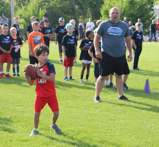 Youth learned all the basic football drills including how to throw and catch a football, run routes and to how to carry the football.