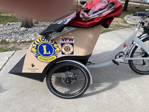 trishaw with logos