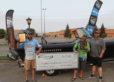 Chuck Hasse (left) and Randy Topper (middle) won the 2019 Warrior Boats National Championships Shootout and a Warrior 1989DC boat powered by a 150 Yamaha.