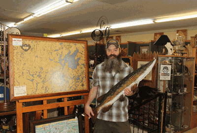 Joel Mensch has owned The Art and Antique Mall and Heritage Custom Framing on main street in downtown Walker for several years, moving to his present location about six years ago.
