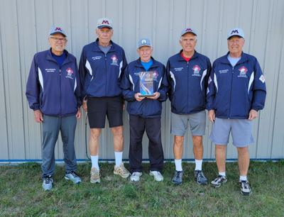 Local players pictured with the trophy are (from left) Steve Baker, Jim Wheeler and Art Glidden from Bemidji, Rich Majcin from Laporte and Jon Thomsen of Park Rapids.