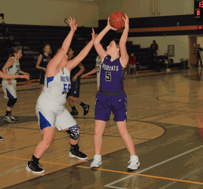 Aleiah Rosenau looks for a teammate to pass the ball to in Laporte's home game with Northome-Kelliher.