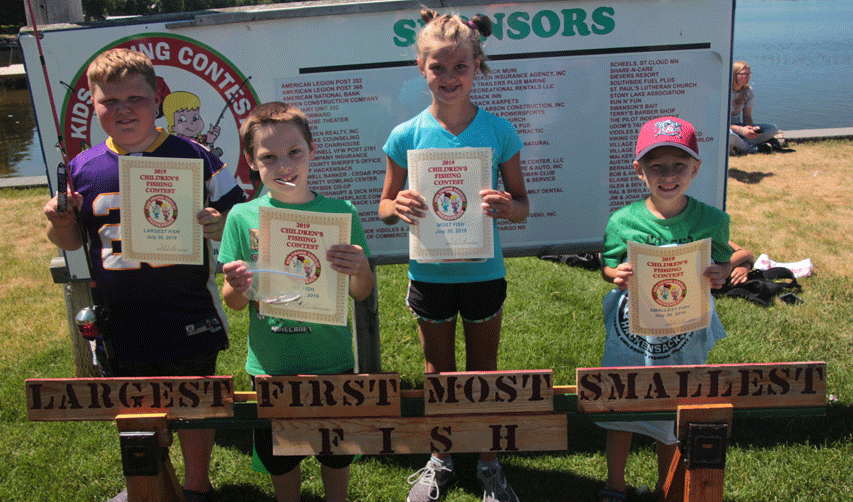 (6-9 years old) Charles (from left)caught the largest fish (5.15 ounces), Mason the first, Chloe the most fish (8) and Colin the smallest (2 inches).