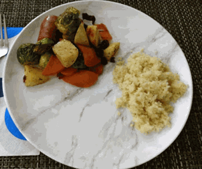Chicken apple sausages, sweet potatoes, apples, brussel sprouts with couscous