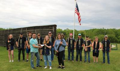 The Walker-Hackensack-Akeley Wolves Trapshooting Team was recently presented with a $900 check from Pine Point Resort owners Jeff and Terra Anderson.