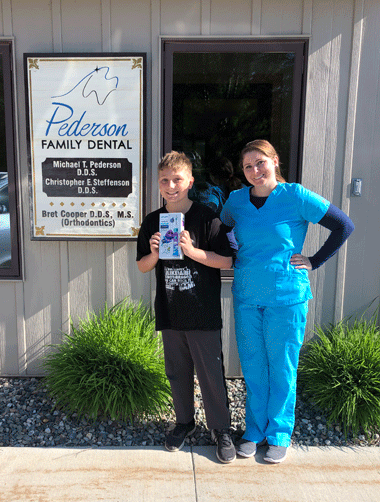 Keaton Smith of Laporte, pictured with new dental assistant Megan Chmielewski, won a new Sonicare toothbrush.