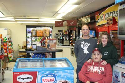 Pat and Karen Shearen and son Luke take a break near the food, beverage and snacks section of Southside Fuel Plus.