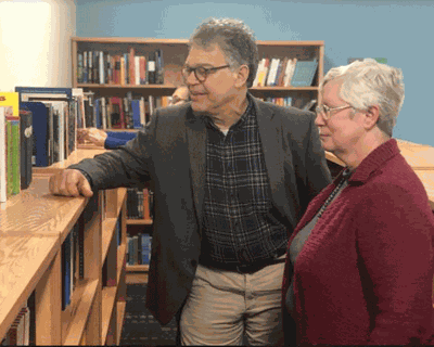 Media Specialist Laurie Villwock showed Al Franken the library's collection.