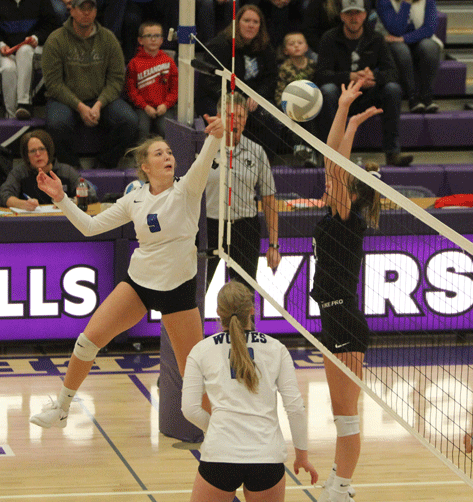 Katie Sagen tips this ball by a Belgrade-Brooten-Elrosa defender early in the match, which ended up going five sets.