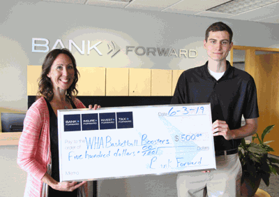 Bank Forward Assistant Vice President Heidi Thole hands a sponsor check for $500 to Chris Duff for the inaugural Leech Lake Basketball Tournament.