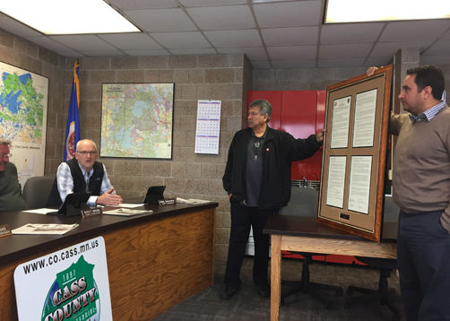 A framed copy of a Memorandum of Understanding was presented to the Cass County Commissioners.