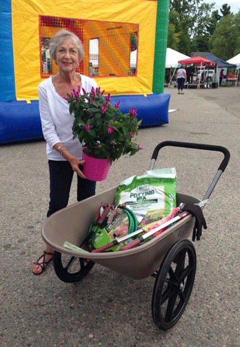 Carol Charpentier won the wheelbarrow filled with gardening goodies from Arrowhead Builders.