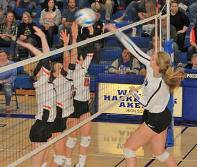 Megan Benjmain records one of her career-high and school-record 33 kills.