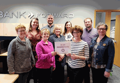 Pictured are (from left) Ronda Hopen, Jessica Johnson, Tara Standfield, Mark Sylstad, Jeanne Kelley, Heidi Thole, Cherrie Bargman, Brent Asell and Suzanne Smith.