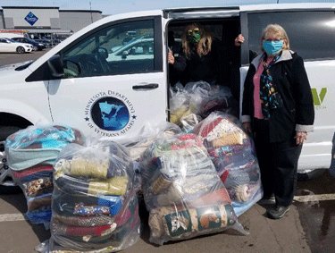 Pictured is Joyce Scott, Public Relations coordinator for the Silver Bay Veterans Home (in the van) and Auxiliary Member Rosanne Gregory.